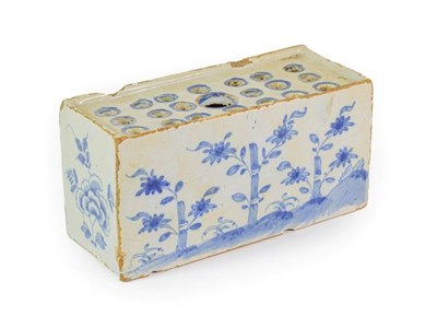 Lot 21 - An English Delft Flower Brick, circa 1750, of rectangular form, painted in blue with bamboo and...