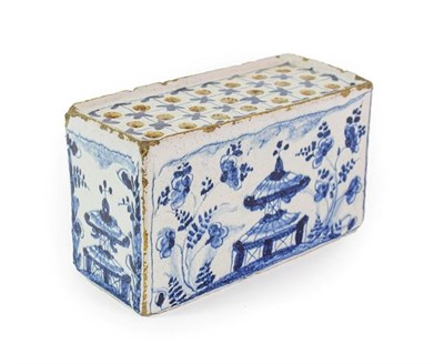 Lot 22 - An English Delft Flower Brick, circa 1740, of rectangular form, painted in blue with pagodas...