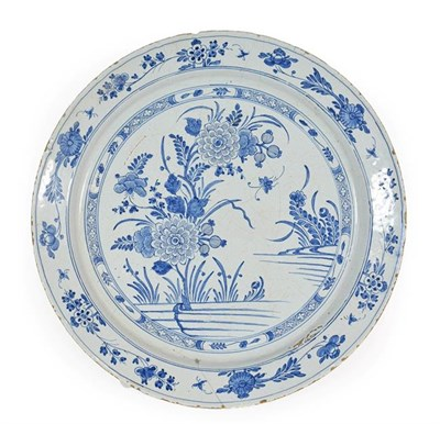 Lot 24 - An English Delft Charger, possibly Liverpool, circa 1750, painted in blue with peony within a...