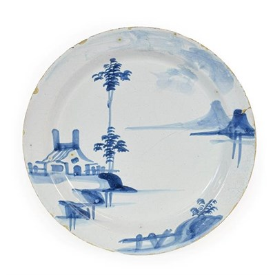 Lot 25 - An English Delft Pancake Plate, probably Lambeth, circa 1740, painted in blue with a...
