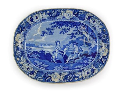 Lot 32 - A Pearlware Meat Platter, circa 1820, printed in underglaze blue with a musical shepherd...