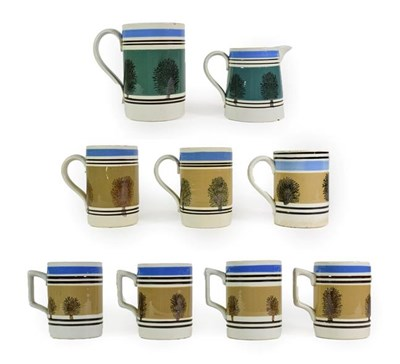 Lot 34 - A Set of Four Mochaware Small Mugs, late 19th/early 20th century, with typical decoration on a buff