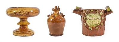 Lot 37 - A Buckley Slipware Money Box, late 19th century, of baluster form, applied with hens and...