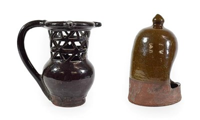 Lot 38 - A Black Glazed Puzzle Jug, 19th century, of traditional form with triple spouts and pierced neck on