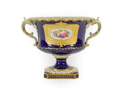 Lot 50 - A Royal Crown Derby Porcelain Campana Shaped Vase, by Albert Gregory, 1915, painted with a spray of