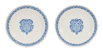 Lot 54 - A Pair of Moustiers Faience Armorial Plates, circa 1730, painted in blue with arms within...