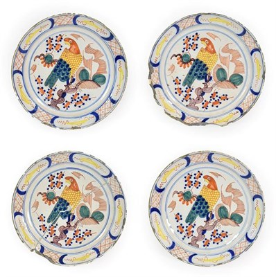 Lot 60 - A Set of Four Delft Pancake Plates, circa 1740, painted in colours with a parrot perched in a...
