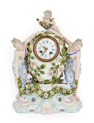 Lot 62 - A Meissen Style Porcelain Cased Mantel Clock, late 19th century, of flower encrusted baluster shape