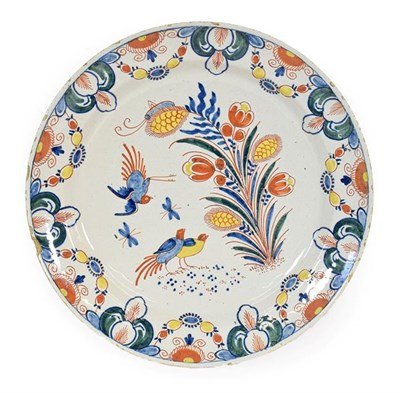 Lot 65 - A Dutch Delft Charger, circa 1730, painted in enamels with birds amongst foliage within foliate...