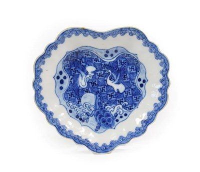 Lot 86 - A Chinese Porcelain ''Ko-Sometsuke'' Dish, mid 17th century, of fluted leaf shape, painted in...