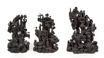 Lot 88 - A Chinese Rootwood Three Piece Garniture, late 19th century, carved with figures and buildings...