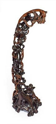Lot 91 - A Chinese Hardwood Carving, late Qing Dynasty, carved and pierced as lily leaves, tendrils and seed