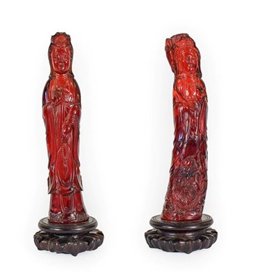 Lot 93 - A Matched Pair of Chinese Pressed Amber Figures, late 19th/20th century, each modelled as...