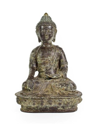 Lot 94 - A Sino-Tibetan Bronze Buddha, in 17th century style, seated cross-legged on a lotus cast base, 40cm