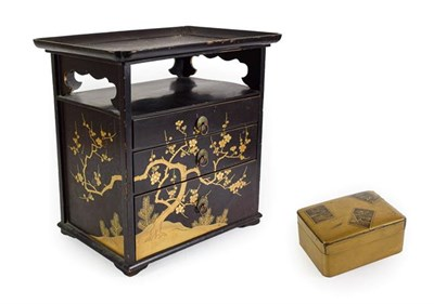 Lot 98 - A Japanese Lacquer Table Cabinet, late, with tray top over a shelf and three graduated drawers...