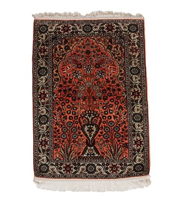 Lot 310 - Kashmir Silk Prayer Rug, modern The bright terracotta field with an urn issuing flowers beneath the