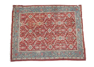 Lot 311 - Sultanabad Carpet West Iran circa 1900 The brick red lattice field of stylized flowerheads enclosed