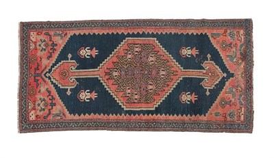 Lot 312 - North West Persian Rug, circa 1920 The deep indigo field with stepped anchor medallion framed...