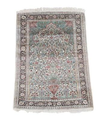 Lot 313 - Kashmir Silk Piled Prayer Rug North West India, circa 1965 The cream field with an urn issuing...