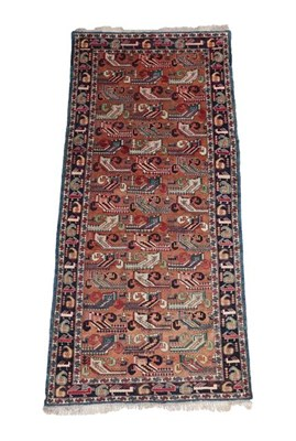 Lot 314 - Kuba Rug North East Caucasus, circa 1920 The biscuit field with columns of stylised plants,...