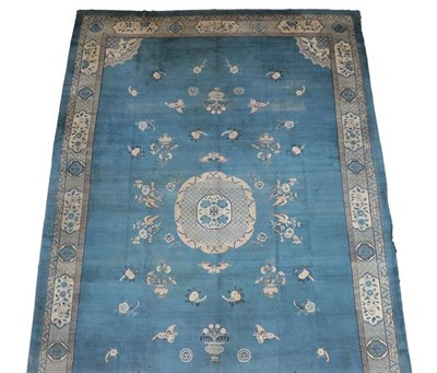 Lot 315 - A Chinese Design Carpet, possibly Turkish circa 1920 The pale indigo field with central roundel...