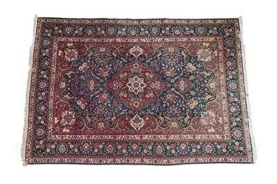 Lot 316 - Tabriz Carpet North West Iran, circa 1950 The deep indigo field of animals and flowers around a...