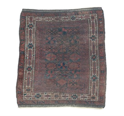 Lot 318 - Baluch Rug West Afghanistan, 19th century The compartmentalised field of stylised flowerheads...