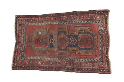 Lot 320 - Kazak Rug Central Caucasus, circa 1900 The deep terracotta field with central 'shield' enclosed...