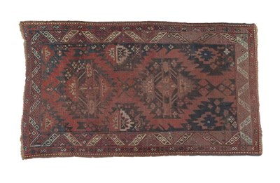 Lot 321 - Karabagh Rug South Caucasus, circa 1880 The indigo field with two serrated güls enclosed by...
