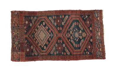 Lot 322 - Kurdish Rug West Iran, circa 1920 The indigo field with two serrated medallions enclosed by...