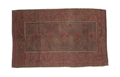 Lot 323 - Baluch Rug Iranian/Afghan Frontier, 19th century The honeycomb lattice field enclosed by...