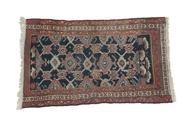 Lot 324 - Hamadan Rug West Iran, circa 1920 The deep indigo field with a lattice of stylised flowerheads...