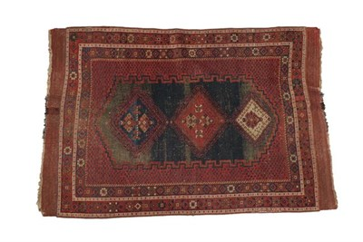 Lot 325 - Afshar Rug South East Iran, circa 1910 The abrashed stepped lozenge field with three hooked...