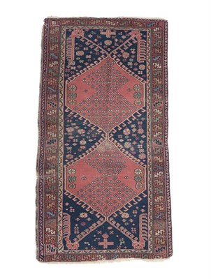 Lot 329 - Isparta Rug Central Anatolia, circa 1900 The deep indigo field with two hooked medallions...