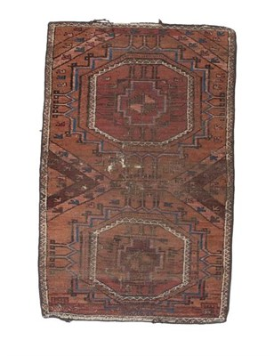 Lot 330 - Afghan Baluch Rug, circa 1900 The field with two octagonal güls enclosed by narrow borders,...