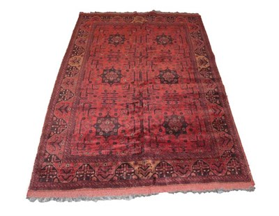 Lot 332 - Afghan Turkmen Rug The compartmentalised field enclosed by narrow borders, 195cm by 128cm