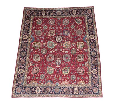 Lot 337 - Good Tabriz Carpet North West Iran, circa 1950 The blood red field with an allover Shah Abbas...
