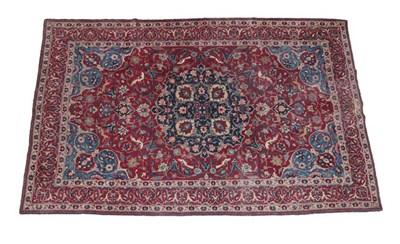 Lot 342 - Tabriz Carpet North West Iran, circa 1925 The rich raspberry field of palmettes, exotic birds...