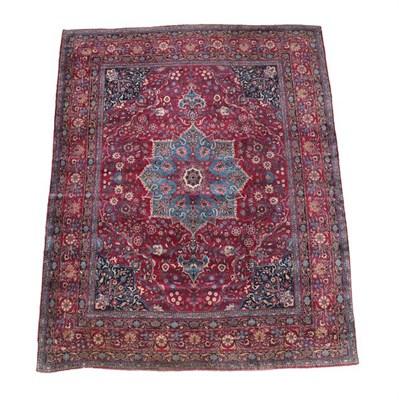 Lot 343 - Kirman Carpet South East Iran, circa 1930 The raspberry field centred by a sky blue medallion...