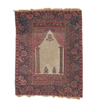 Lot 351 - Giordes Prayer Rug Central Anatolia, probably 18th century The plain ivory field with two...