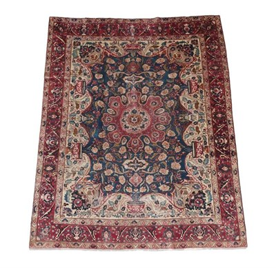 Lot 352 - Kashmar  Central East Iran, circa 1930 The indigo field of large flowerheads around a...