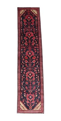 Lot 354 - Malayir Runner West Iran, circa 1940 The indigo field of large flowering plants framed by spandrels