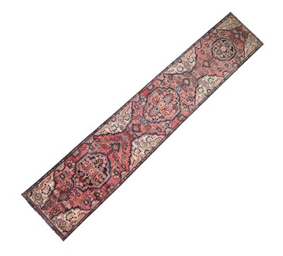 Lot 355 - Malayir Runner West Iran, circa 1930 The faded rose pink field of flowers flanking medallions...