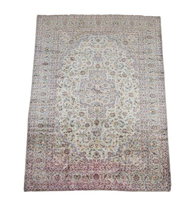 Lot 356 - Kashan Carpet Central Iran, circa 1970 The duck egg blue field of leafy vines and palmettes...