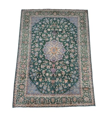 Lot 357 - Isfahan Region Carpet Central Iran, 2nd half 20th century The British racing green field of...