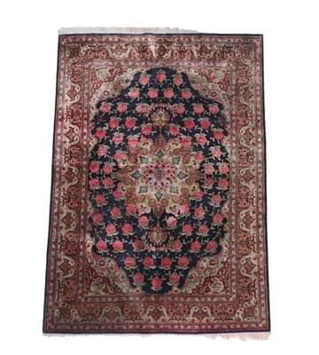 Lot 358 - Ghom Silk Rug Central Iran, 2nd half 20th century The deep indigo field of naturalistic roses...