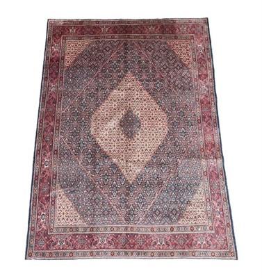 Lot 361 - Moud Khorasan Carpet East Iran, 20th century The indigo Herati field enclosed by brick red...