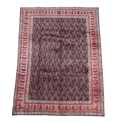 Lot 363 - Khorasan Carpet East Iran, circa 1940 The field with an allover design of boteh enclosed by...