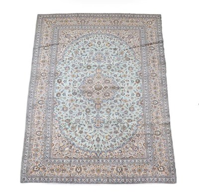 Lot 364 - Kashan Carpet Central Iran, circa 1970 The ice blue field of palmettes and vines around a...