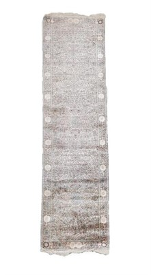 Lot 365 - Kashmir Silk Runner North West India, circa 1960 The pale candy pink field of exotic birds and...